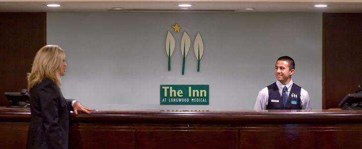 welcoming front desk at inn at longwood medical